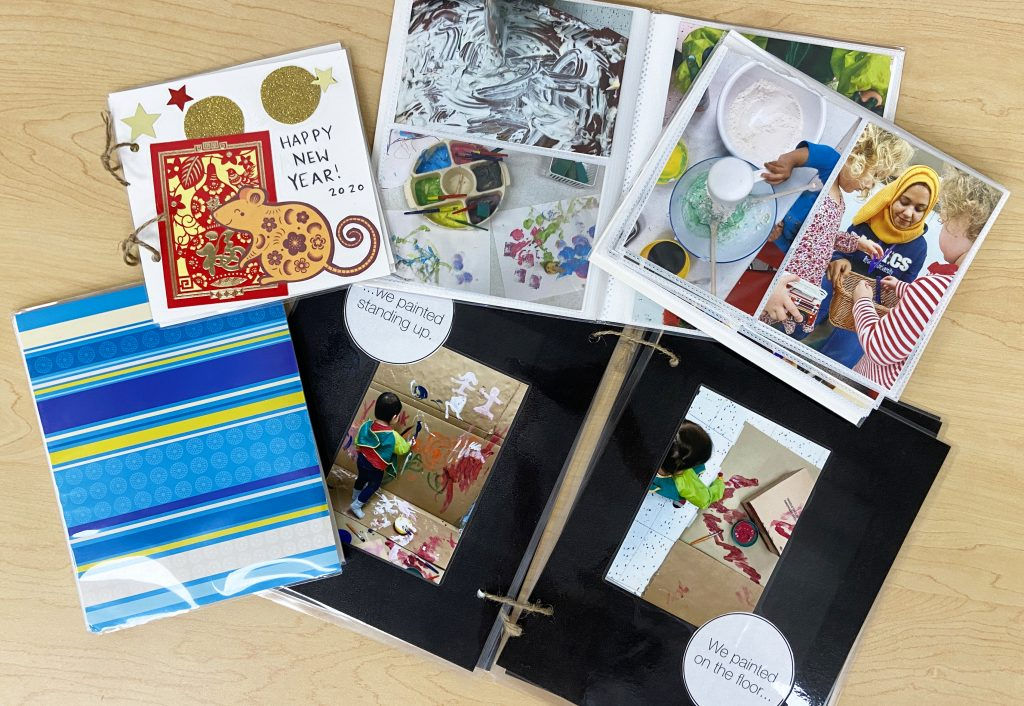 A selection of handmade books for a child's home library including scrapbooks, artwork, and photo albums