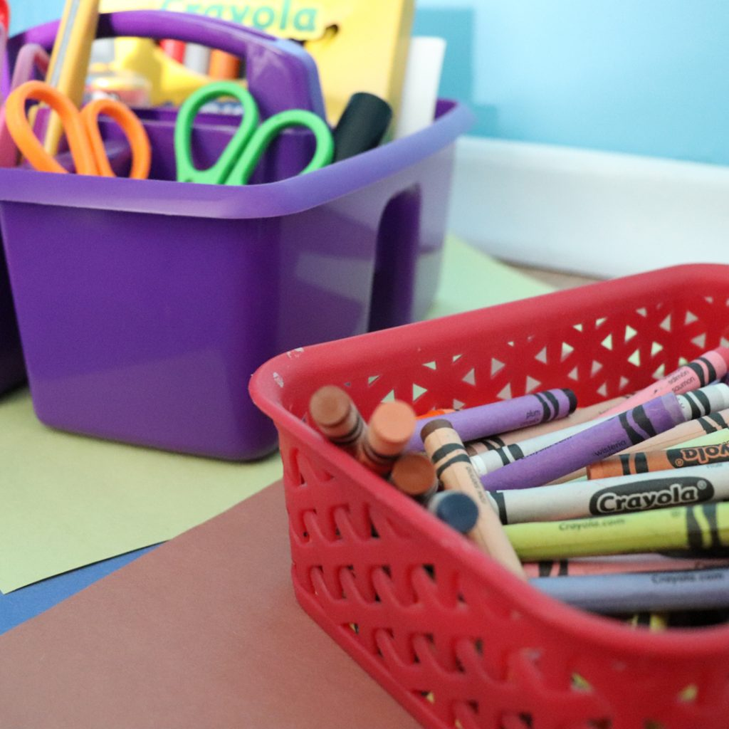 Crayons, scissors and paper for a child's creative play space