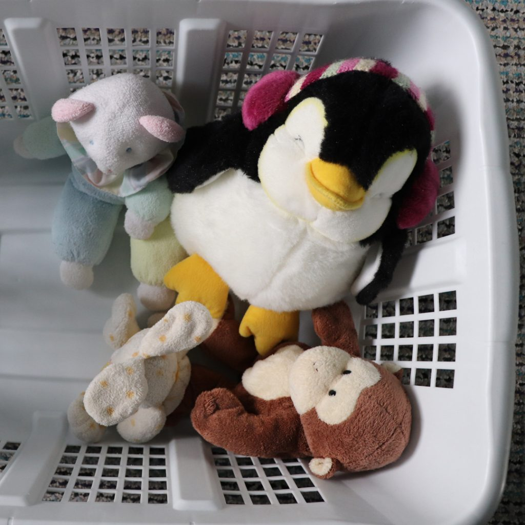 Toys inside laundry basket for a dramatic play space