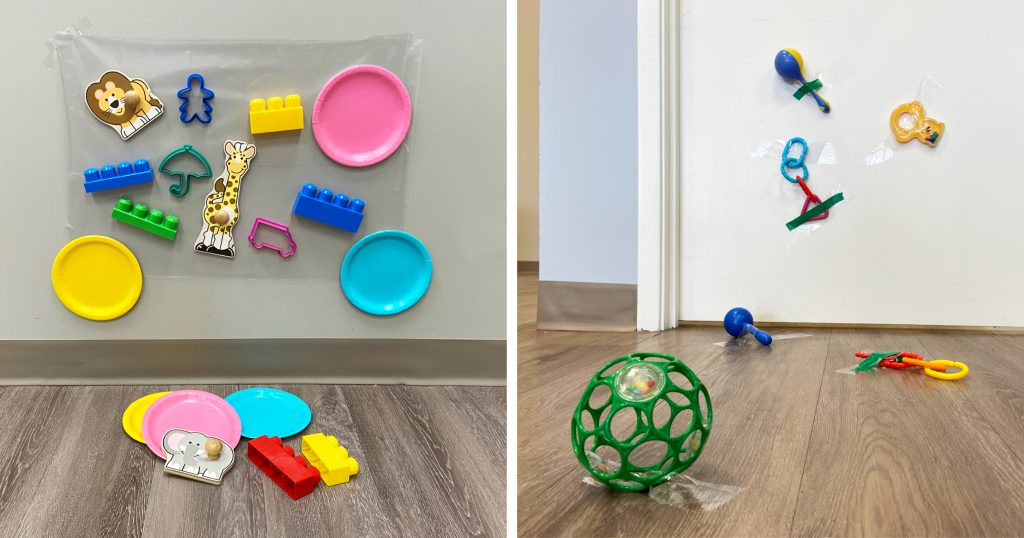 Baby toys taped to a wall and floor as an active play activity for babies