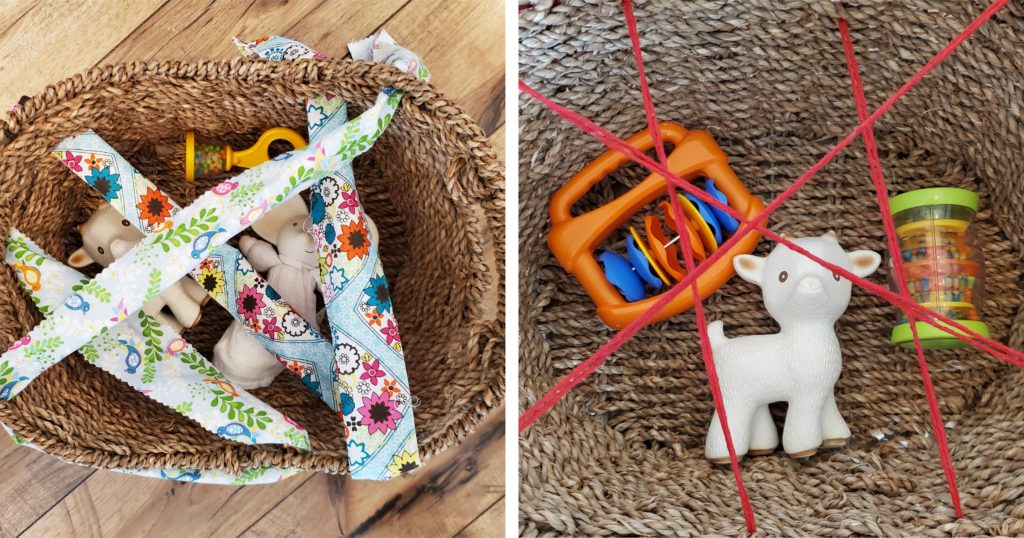 Three baby toys in a basket covered with string and ribbon as an active play activity