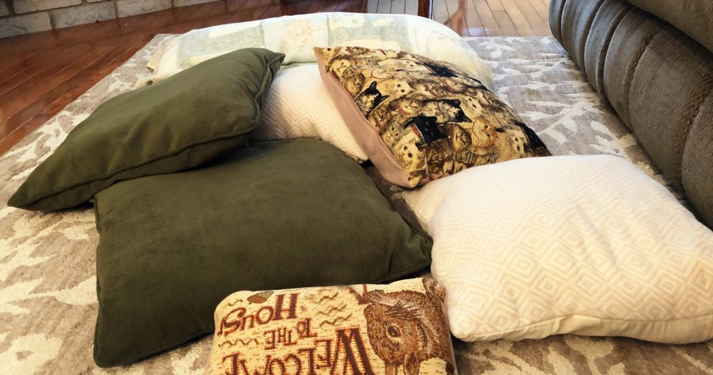 A pile of pillows on a carpet