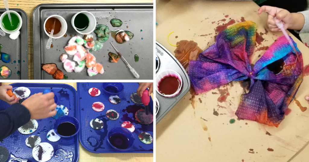 A toddler paintes on cotton balls, cotton pads, and a coffee filter using a pipette to dispense water mixed with food colouring