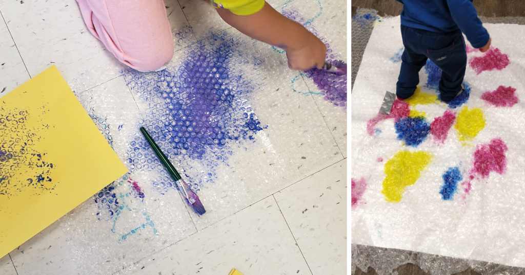 A child paints on bubble wrap with a paintbrush and their feet