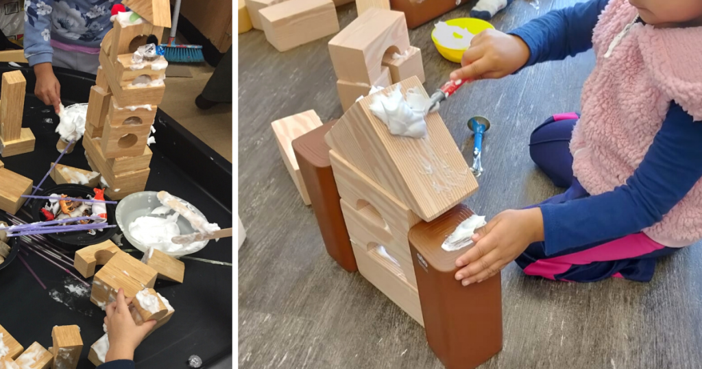 A child paints on shaving cream to foam blocks and builds structures