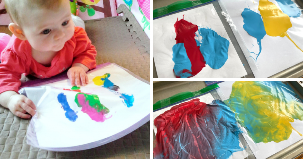 Baby plays with paint inside a clear bag