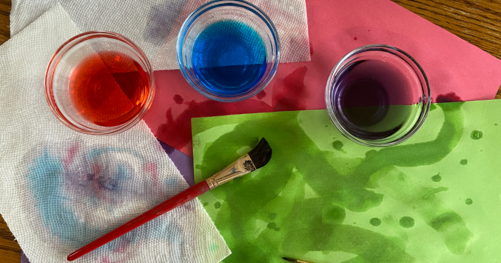Art made by painting water mixed with food colouring on paper and paper towels