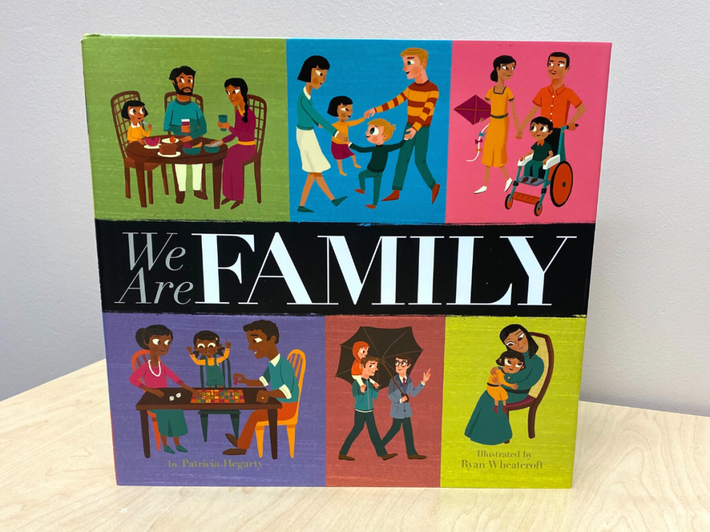 A children's book with illustrations of families reading We Are Family. Books like this make for a fun Family Day story time activity.