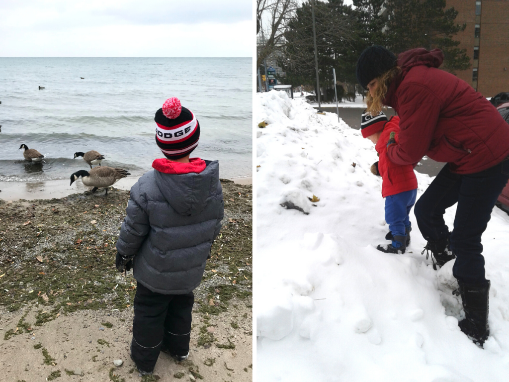 A preschool aged child looks out at a lake and a toddler climbs a snow bank with an adult while on a nature walk on Family Day.